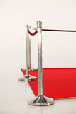 Silver Stand and Red Carpet Railing with Rope royalty free stock images