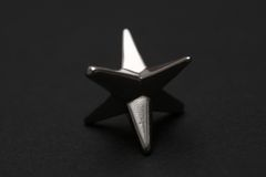 Silver Star. Against a black background Royalty Free Stock Photography