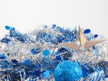 Silver star and blue ball on the colorful streamer Stock Photo