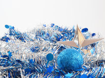 Silver star and blue ball on the colorful streamer Stock Image