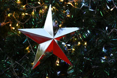Silver Star Christmas on christmas tree background Stock Photos