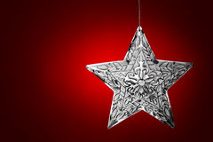 Silver Star Christmas Ornament Over Red Leather Royalty Free Stock Photography