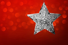 Silver Star Christmas Ornament Red Brushed Metal. Silver Star Christmas Ornament Over Brushed Metal Background With Blurred LED Bokeh Lights Stock Image