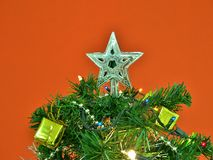 Silver star decorated on the top of Christmas tree. Royalty Free Stock Images