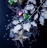 Silver star, gift boxes and frosty white leaves Stock Photography
