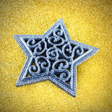 Silver star on gold Royalty Free Stock Images