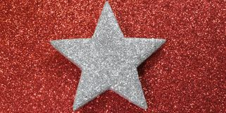 Silver star of sheriff shining red luminescent background Stock Photo
