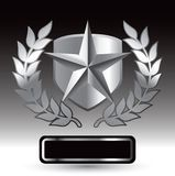 Silver star on shield with leaves over nameplate Royalty Free Stock Image