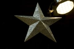 Silver star and stage light. Silver star and old stage light as details of decoration Royalty Free Stock Images