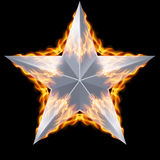 Silver star surrounded by fire. Silver five-pointed star surrounded by fire on black background Stock Photography