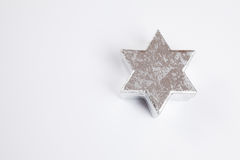 Silver star, white background, copy space Stock Photo