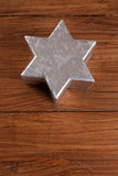 Silver star on wood, copy space Stock Images