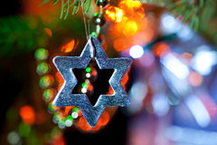 Silver star on Xmas tree Royalty Free Stock Photo