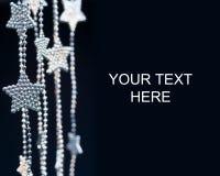 Silver Stars garland on dark background Royalty Free Stock Image