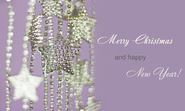 Silver Stars garland on purple background Stock Photos