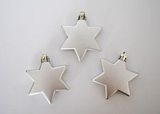 3 silver stars. Silver stars on white background Stock Photography