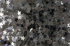Silver starshaped sequins Stock Images