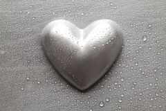 Silver statuette in the shape of hearts on a metal plate Royalty Free Stock Photo