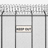 Silver or Steel Fence with Barbed Wire and Keep Out Sign Royalty Free Stock Image