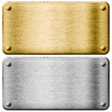 Silver steel and gold metal plates Royalty Free Stock Photo