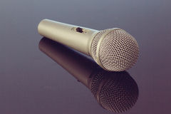 Silver steel microphone lying on table Royalty Free Stock Photo