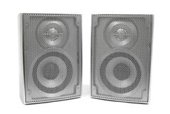 Silver stereo speakers. On white stock photos