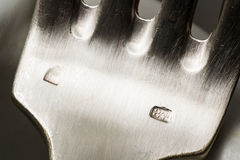 Silver sterling fork stamp macro Royalty Free Stock Photography