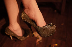 Silver Stiletto shoe on woman's foot. Silver high heel shoes at party on lady's feet stock image