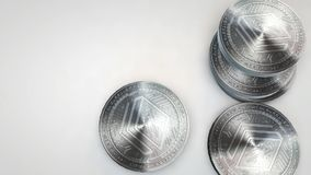 Silver stratis coins falling on white background. Animation stock video