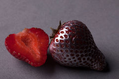 Silver strawberry with slice Royalty Free Stock Photo