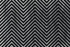 Silver stripes on black background, chevron. Royalty Free Stock Images