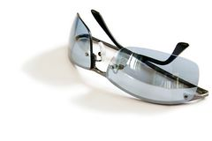 Silver Sunglasses. Elegant silver sunglasses resting on a white surface. Isolated with shadow Stock Images