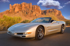 Silver Sunset. A convertible sports car reflects mountains and sky Royalty Free Stock Photography