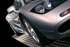 Silver supercar. On a display stand with black background Stock Image