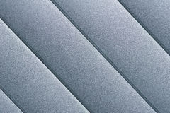Silver Surface Detail of Roller Blind. Close up detail of silver grey roller door/blind with parallel striped lines Royalty Free Stock Photos