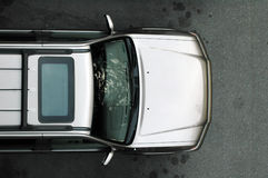 Silver SUV from Above. A silver SUV shot from above royalty free stock images