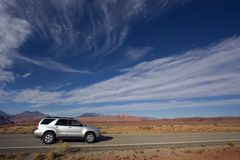 Silver SUV driving in Utah. Stock Images