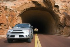 Silver SUV driving in Utah. Royalty Free Stock Images