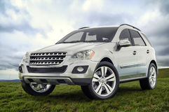 Silver SUV. Standing on the grass Stock Photos