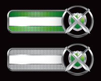 Silver swords and shield on specialized banners. Silver swords and shield on specialized green and silver checkered banners Stock Images