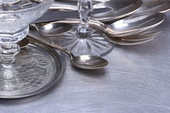 Silver table setting with fork, knife, spoon and glass Stock Photography