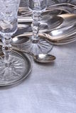Silver table setting with fork, knife, spoon and glass Royalty Free Stock Photos