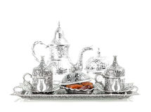 Silver tableware, dates, tea andcoffee cups Royalty Free Stock Image