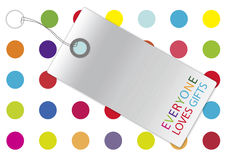 Silver tag with gift box. Royalty Free Stock Images