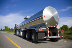Silver Tanker. Parked on the road with a blue sky and clouds Royalty Free Stock Image