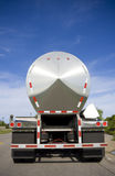 Silver Tanker. Parked on the road with a blue sky and clouds Royalty Free Stock Photo