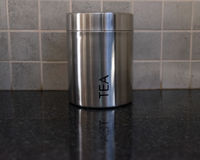 Silver Tea Container on a kitchen counter stock images