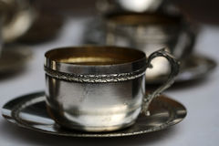 Silver tea cup with saucer Stock Image