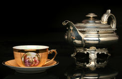 Free Silver Teapot And An Antique Chinese Cup Of Tea Stock Photo - 10525570