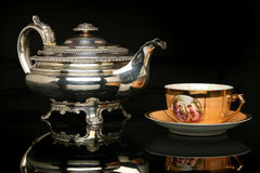 Silver teapot and an antique chinese cup of tea Royalty Free Stock Photography